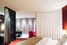 Hand Operated Circular Curtain Track System used as a room divider in a Hotel Room