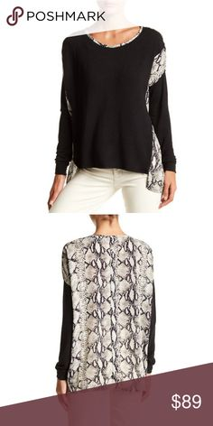 Papillon Hi-Lo Snake Print Blouse Medium Black A snakeskin print frames the back and neck of this hi-lo hem blouse.      - Boatneck     - Drop shoulder long sleeves with ribbed cuffs     - Snake print on back     - Hi-lo vented hem   Fiber Content     100% polyester Care     Hand wash cold Additional Info     Fit: this style fits true to size. Papillon Tops Blouses