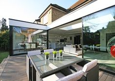 Contemporary single storey extension to a family home in London. They wanted to bring a sense of openess to their semi detached home. We did this by including an L shaped extension with a raised deck to create inside and outside living spaces. House Extension Plans, House Extension Design, House Design, Extension Ideas, L Shaped Kitchen Extension, Glass Extension, Rear Extension, Small Room Layouts, House Layouts
