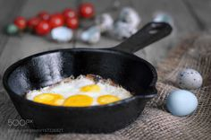 Fried quail eggs in a skillet by galinabondarenko1