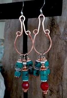 Interesting earrings.  Can't wait to make my version of them!