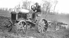 Henry Ford experiments with a prototype Model T-based tractor.