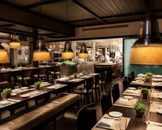 Located on the first two floors of The Mercer hotel at 99 Prince Street, Chef Jean-Georges Vongerichten serves an American Nouveau menu at The Mercer Kitchen. Long communal tables flank the basement dining area with an open kitchen where patrons can watch the culinary masters at work.