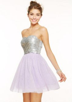 Score major fashion points on the dance floor in this sparkly strapless dress with a sequin bodice and glitter tulle skirt. Back zipper, fully lined.