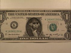 Dollar bills serve as artist's canvas Artist Sean Monaghan