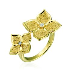 Floating Flower rings by Gumuchian in 18k yellow gold, with 0.05 ct. t.w. diamonds; $2,000
