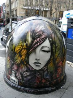 Beautiful street art on trash container