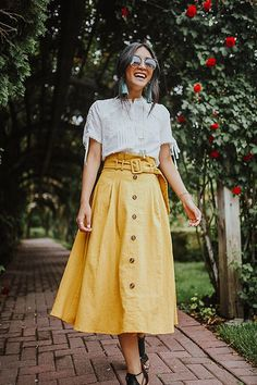A statement-making ensemble starts with the Seaport Mustard Paperbag Midi Skirt! Adjustable belted paperbag high waist shapes a long, flared midi skirt. On-trend buttons in the front and a hidden back zipper with a clasp. Yellow Skirt Outfits, Midi Skirt Outfit, Midi Flare Skirt, Pleated Midi Skirt, Yellow Maxi, Basic Fashion, Look Fashion, Girl Fashion, Womens Fashion