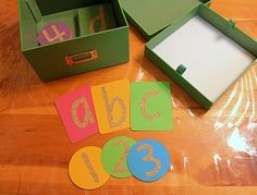 make sand paper letters and numbers for crayon rubbings and for tactile learning