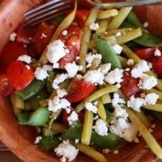 Green and wax beans with cherry tomatoes http://www.epicurious.com/recipes/food/views/Green-Bean-Yellow-Bean-and-Cherry-Tomato-Salad-103487  ...add cheese