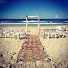 Perfect day for the wedding of Carla & Joel! Styling by www.breezeweddings.com.au #surfersparadisewedding #mainbeachwedding #wedding #bambooarbor #bambooarch #bambooweddingarch #breezeweddingsaustralia