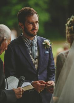 Groom wears a blue checked suit with a tweed waist coats and chequered shirt | Photography by http://howelljonesphotography.co.uk/