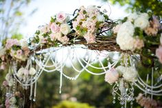 Wedding Canopy & Arches - A lovely wedding arch with bouquets of lush flowers and strings of pearls and crystals!  #Wedding #Altar #WeddingCanopy  #WeddingArch #Ceremony