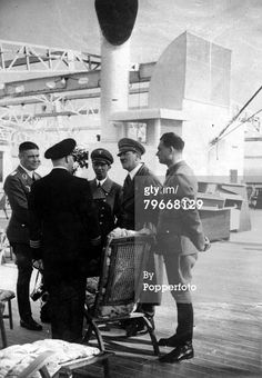 Joseph Goebbels, Adolf Hitler and Rudolf Hess talking with Captain von Frideburg aboard the ship Scharnhorst on May.7, 1935