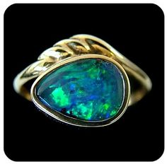 opals | BLACK OPAL PEAR SHAPE IN 18K YELLOW | opal rings 1 closed