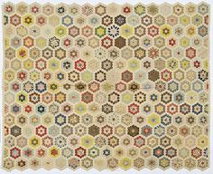 """Honeycomb Quilt Top - Cowan's Auctions.  American, 19th c., entirely constructed from 1/2"""" hexagonal pieces of printed and solid cotton fabrics, 72.75"""" x 60""""."""