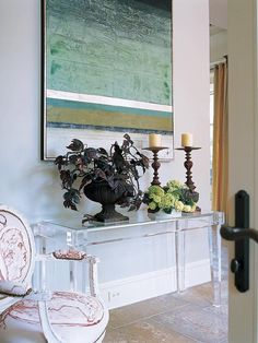 Entryway With Lucite Console Table and Louis XVI Armchair - on HGTV