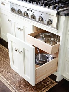Trick Cabinets  Faux double cabinet doors conceal pullout drawers for pots, pans, and lids. Because the unit pulls out, it is less likely bulky cookware will get lost in the recesses of a cabinet.
