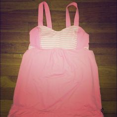 Lululemon Pink Tank This is a lululemon bubble gum pink tank with a built in bra. The loose tank exposes a little bit of back below the bra. It has a draw string closure on the bottom. Can be worn loose though. In great condition, only worn once! lululemon athletica Tops Tank Tops