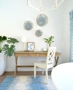 I am really liking this light natural wood with the blue and whites for a light, airy feel.  I think it would work well with the building too.