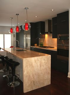 I Would Say My Eye Was Drawn To The Shiny Rangehood And Stunning Red - Red pendant lights for kitchen