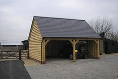 Two bay oak car port with two open bays and pointed roof, built bespoke to the client& requirements. Timber Garage, Carport Plans, Oak Framed Buildings, Thatched House, Old Forge, Carport Designs, Garage Addition, Garages, Storage Spaces