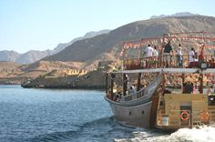 On a boat out in the fjords of Oman.