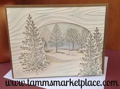 This handmade winter scene card is elegant and sparkles with a glittered snow…