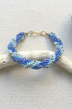 Learn double spiral rope with this free tutorial, an easy stitch that uses twice as many spiral beads in each stitch and results in two distinct spirals.: Two Spirals - Bead Rope Bracelet Seed Bead Jewelry, Bead Jewellery, Beaded Jewelry, Handmade Jewelry, Seed Beads, Jewelry Box, Beading Patterns Free, Beaded Bracelet Patterns, Beaded Bracelets
