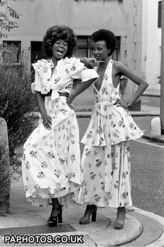 """mariankihogo:  """" Fros on the heads, @OssieClarkLDN on their back and platforms on their feet.  1973.  """""""