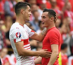 The Xhaka brothers pictured after their Euro 2016 encounter on Saturday in Lens...