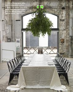 Love the idea of hanging a large bunch of greenery over an outdoor table.