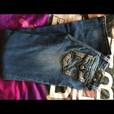 GIRLS MISS ME JEANS These are in good condition. Size 14 in girls. They are missing a few jewels as seen in the pics. But no holes/stains/fraying. Smoke/pet free home. Price reflects the flaws. No trades. Open to offers. Miss Me Jeans Boot Cut