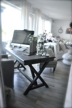 I like how the computer is casually tossed into the living room, but it all still looks so comfy!