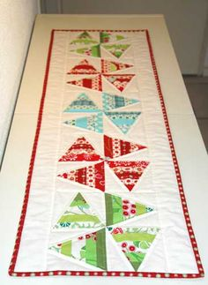 This is just what I was looking for - not too Christmassy!  Christmas table runner( cute cute cute)