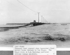 Flooding at the mouth of a swollen Santa Ana River near Newport Beach and Huntington Beach, CA 1927.