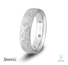 Simon G. Jewelry platinum and diamond men's wedding band.