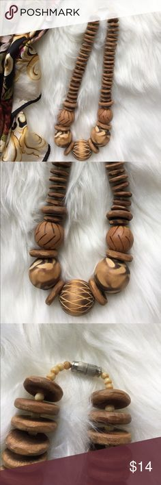 """Wooden Choker Vintage wooden Choker with graduated wood carved balls then highlighted with wooden discs. Screw type closure. Approx 19"""" long. Wonderful pre loved condition. Great estate sale find to complement your Boho wardrobe. Vintage Jewelry Necklaces"""