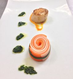 Seared scallop with carrot cream puree and herb oil dressing with ...