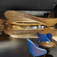 RAW Restaurant Taipei, 2014 by WEIJENBERG Pte Ltd. The unique feature of the design is the continuous natural wooden structure, which runs throughout the restaurant without obvious columns and structural elements holding it up. The structure is elegant and forward-looking and forms the centrepiece of RAW. Photo by MW Photo INC.