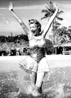 Enjoying Miami Beach and getting wet! (1939)   Florida Memory