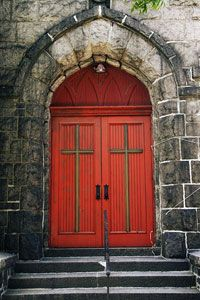 The red door of Good Shepherd United Methodist Church in Astoria, NY,