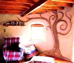 Sculpted clay plaster wall relief from The Mud