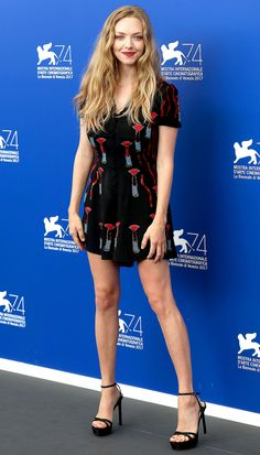 AMANDA SEYFRIED wears a print Valentino dress to the First Reformed photocall at the Venice Film Festival.