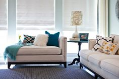 If, instead, you enjoy dressing your upholstered pieces with different pillows and throws every season (or every time you feel like you want a new color palette), go for a neutral chaise. Then you can control how you style it.