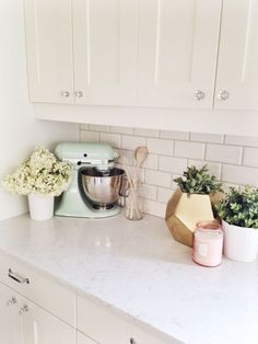 creamy white shaker style kitchen cabinets, subway tile back splash, crystal knobs, nickel pulls, quartz counters Home Decor Kitchen, Diy Kitchen, Home Kitchens, Pastel Kitchen Decor, Kitchen Counter Decorations, Kitchen Ideas, Kitchen Plants, White Kitchen Decor, Kitchen Corner