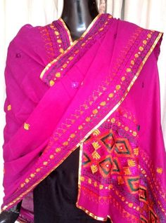This lovely cotton phulkari dupatta is hand embroidered with light phulkari work in thread. It has small geometrical motifs all over, with a heavy border at both ends - See more at: http://giftpiper.com/Cotton-Phulkari-Dupatta-Light-Work-Purple-id-872233.html. Also  see our dupatta online collection at http://giftpiper.com/Stoles-Dupattas-catid-36678-page-1.html