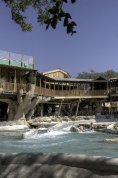 Tree Haus Resort - Nestled on the banks of the spring-fed Comal river, enjoy awesome tree-top views and unlimited use of the Waterpark during your stay, and extended access to some of your favorite rides including the Master Blaster uphill water coaster. These units can sleep up to 12 guests in the three bedroom/two bath Treehaus.