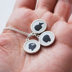 Hello, Mother's Day - Custom Silhouette Necklace via: LePapierStudio $100 {$10/each extra for custom sihouettes}