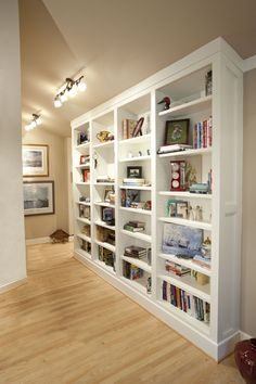 White Bookcaseedia Cabinetry Built Into Corner With Vaulted Ceiling